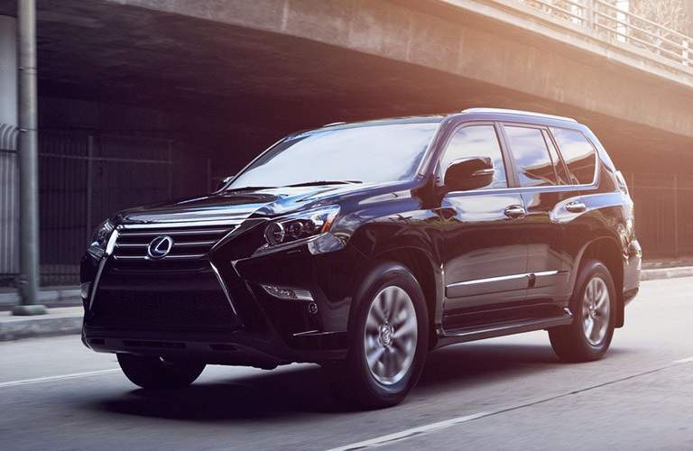 blue 2016 Lexus GX driving through city streets