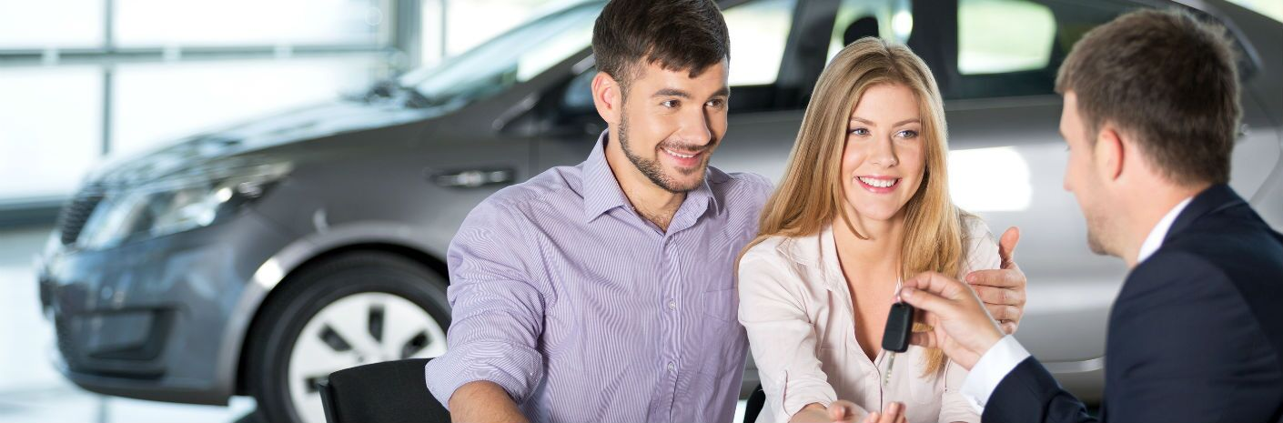 couple buying vehicle at dealership