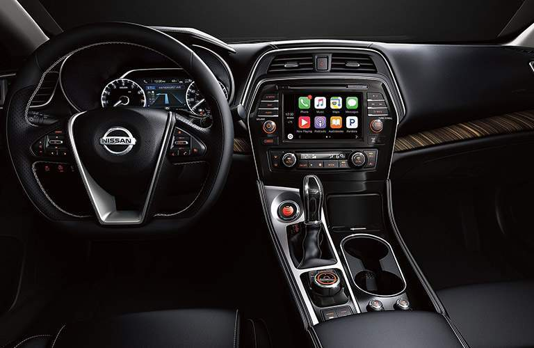 front interior of 2018 nissan maxima including steering wheel, dashboard and infotainment system