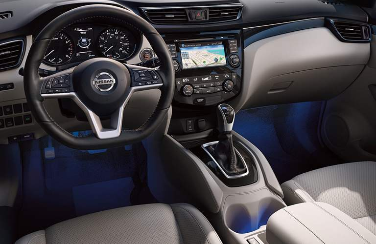 interior view of steering wheel and dashboard in the 2018 nissan rogue