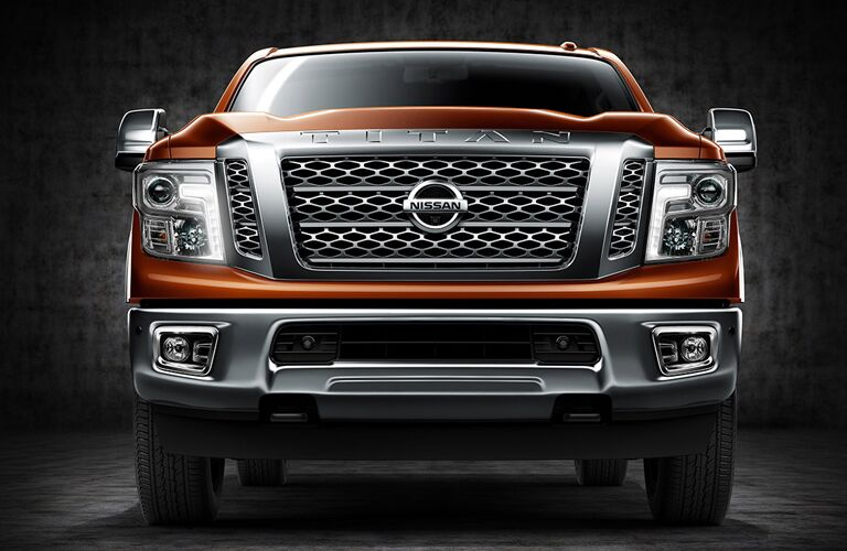 front view of bumper and grille of orange 2018 nissan titan xd