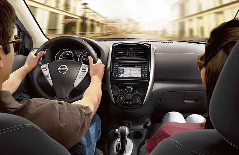 2018 Nissan Versa Sedan front seat with couple driving