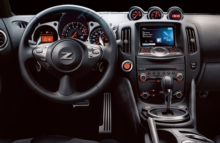 front interior of 2019 nissan 370z including steering wheel and infotainment system