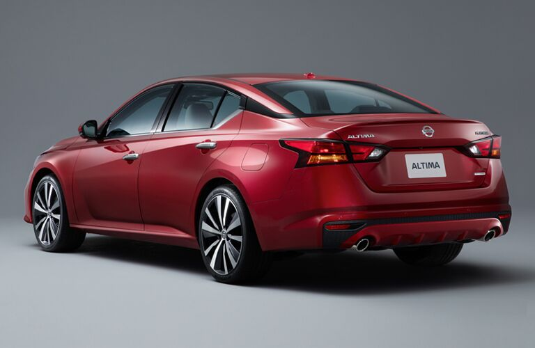 rear and side view of red 2019 nissan altima