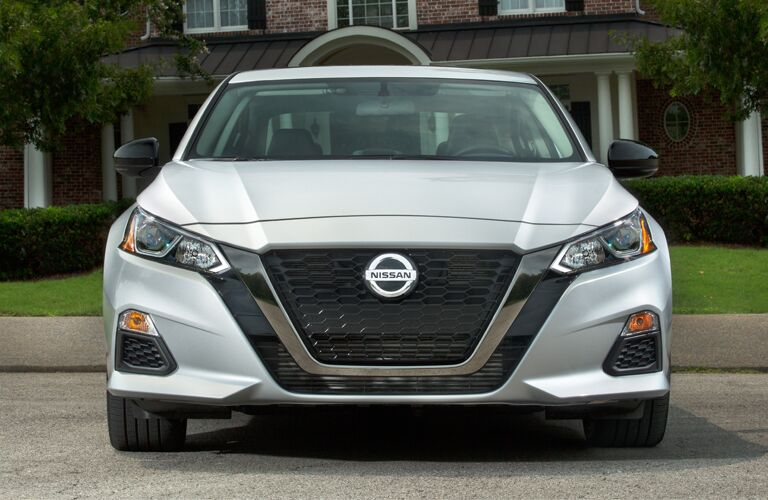 front view of silver 2019 nissan altima including grille and headlamps