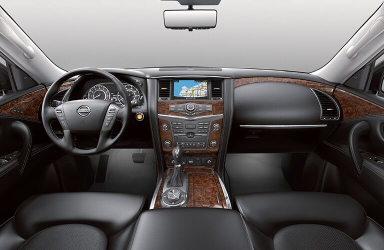 front interior of 2019 nissan armada including steering wheel and infotainment system