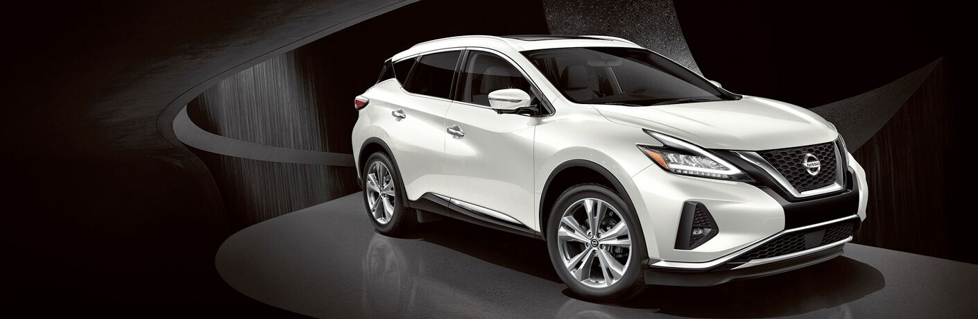 2019 Nissan Murano exterior front fascia and passenger side indoors with dramatic lighting