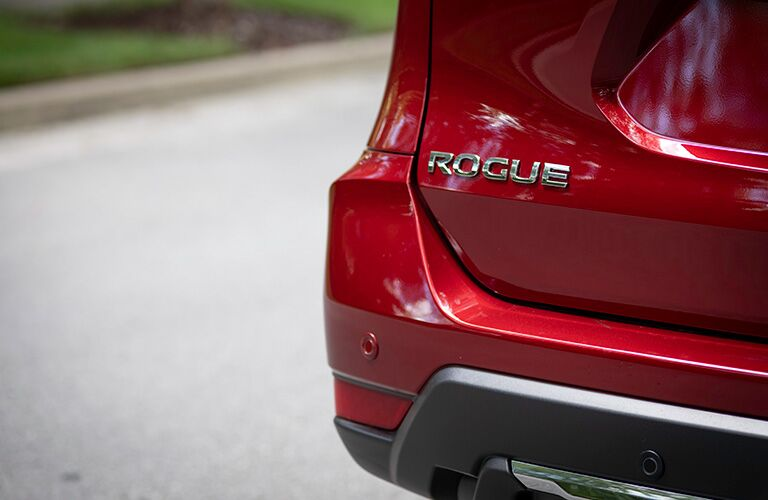 nameplate on rear liftgate of red 2019 nissan rogue