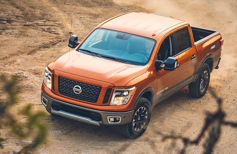 front and side view of orange 2019 nissan titan