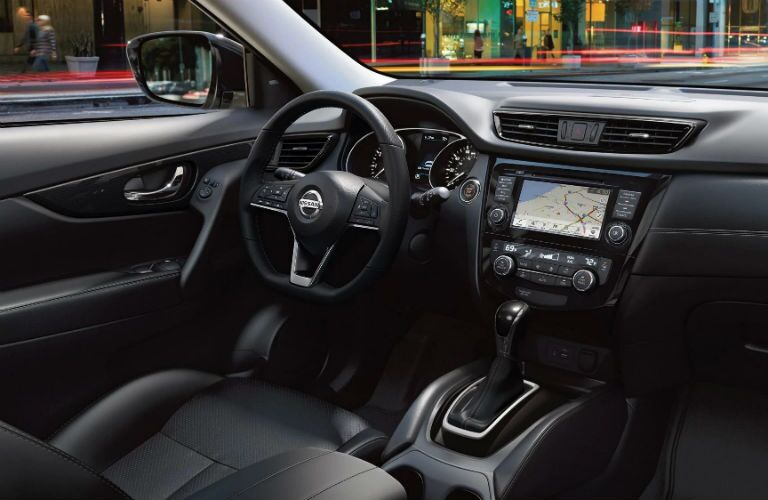 front interior of 2019 nissan rogue including steering wheel and infotainment system