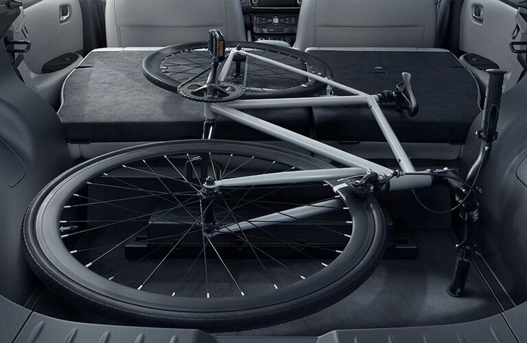 Bike on top of seats folded down inside of the 2020 Nissan LEAF