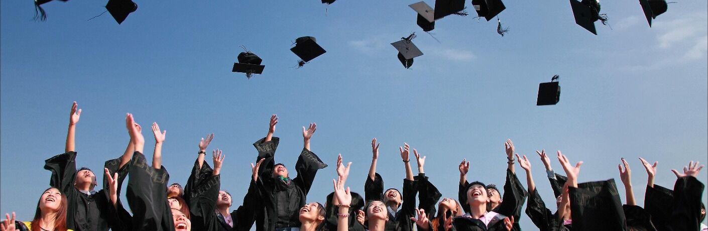 College graduates throwing their caps