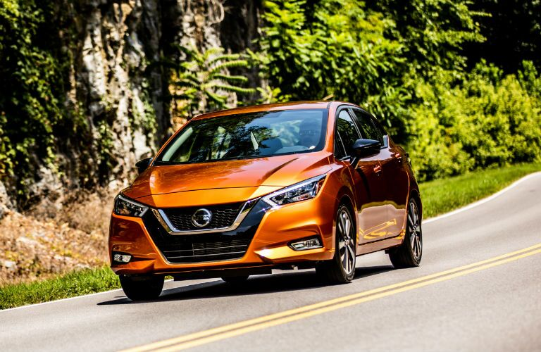 A head-on photo of the 2020 Nissan Versa in motion on the road.