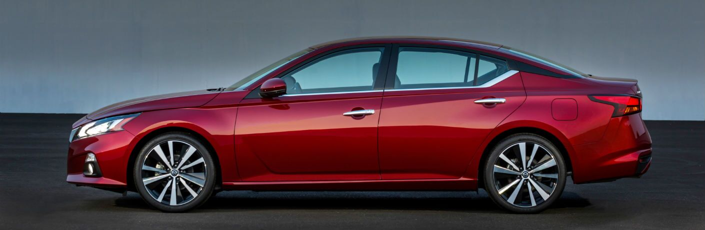 A left profile photo of the 2020 Nissan Altima in a photo studio.
