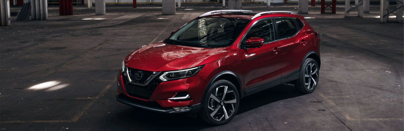 A front left quarter photo of the 2020 Nissan Rogue Sport in a garage.