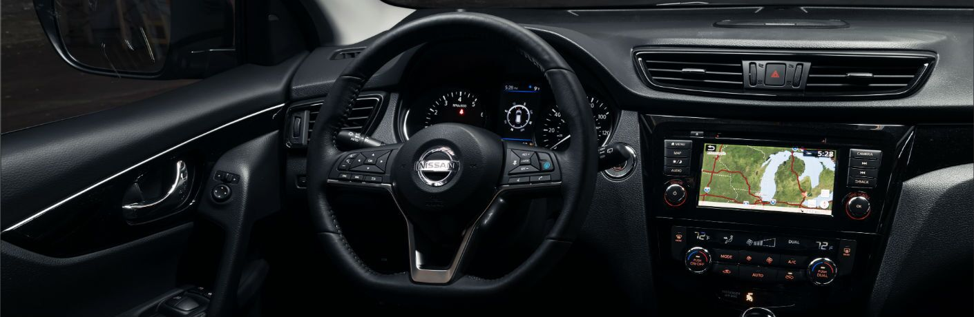 A photo of the driver's cockpit of the 2020 Nissan Rogue Sport.