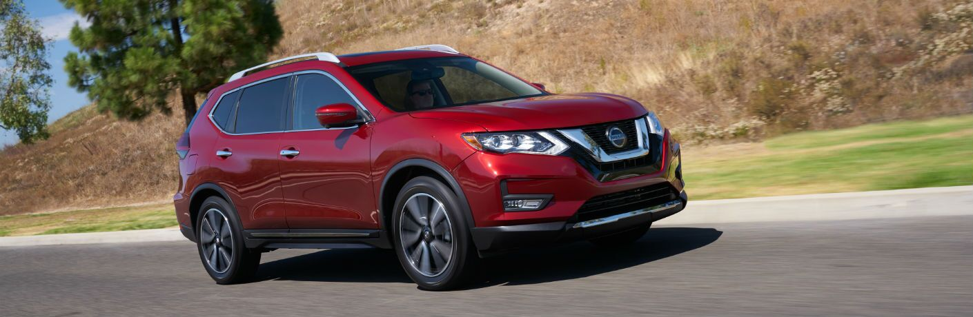 A right profile photo of the 2020 Nissan Rogue on the road.
