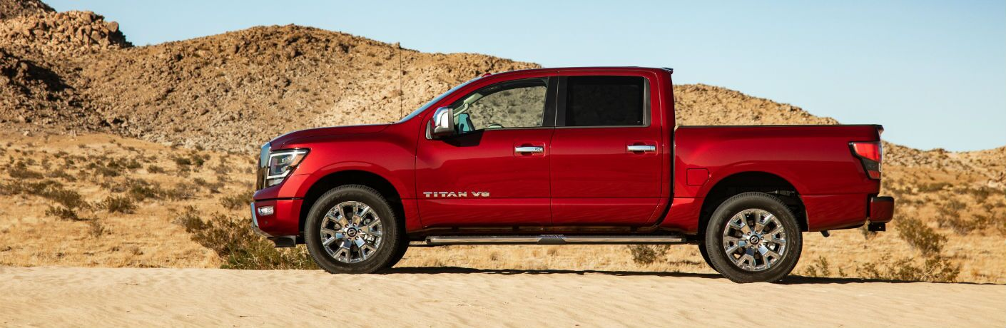 A left profile photo of the 2020 Nissan Titan parked in the desert.