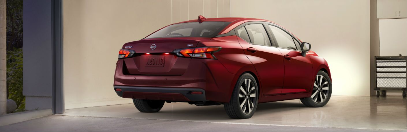 A rear right quarter photo of the 2020 Nissan Versa parked in a garage.