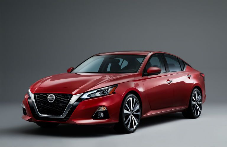 A front left quarter photo of the 2020 Nissan Altima in a photo studio.