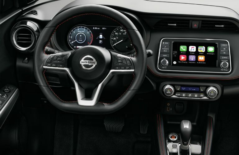 A photo of the driver's cockpit in the 2019 Nissan Kicks.