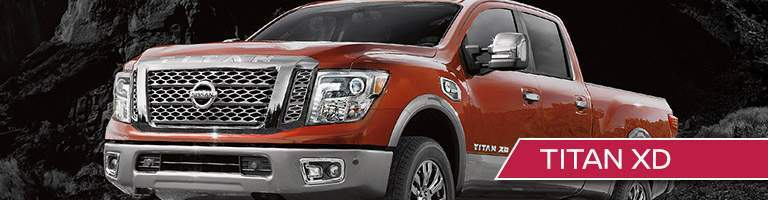 red Nissan Titan XD front side view