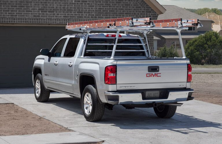 2016 GMC Sierra in white with ladder on top