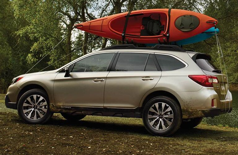 Subaru Outback loaded with kayaks