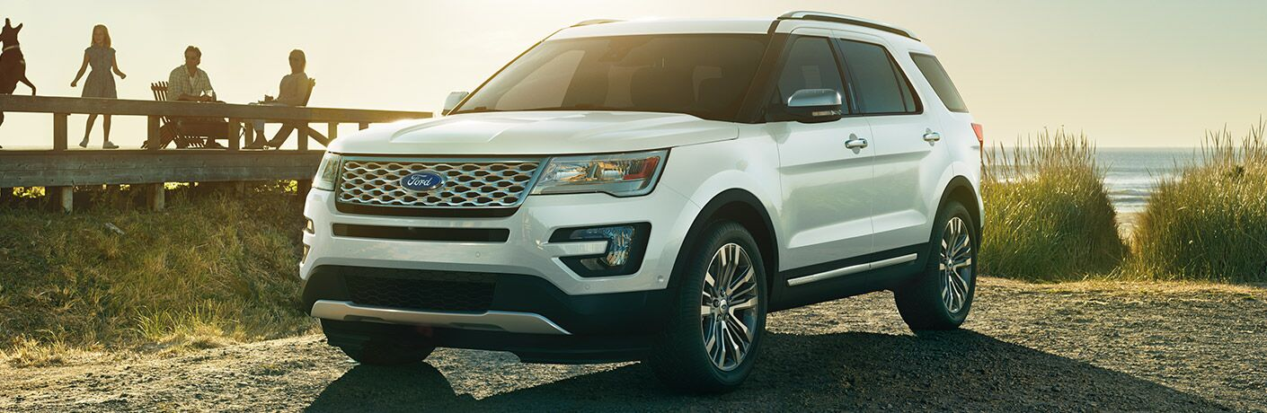 White Ford Explorer near a body of water