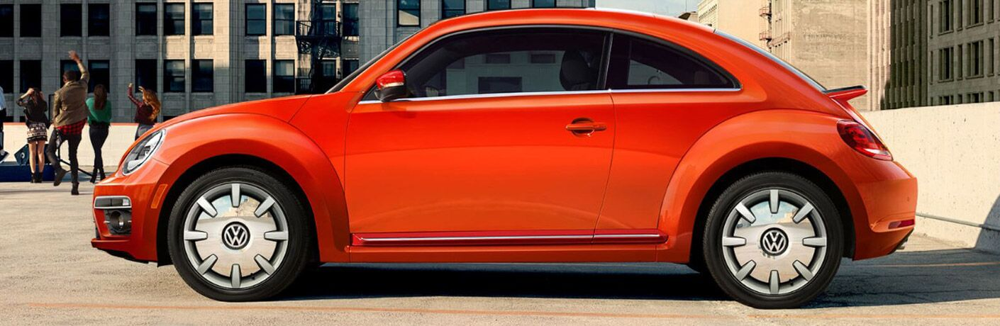 Side profile of orange 2018 Volkswagen Beetle
