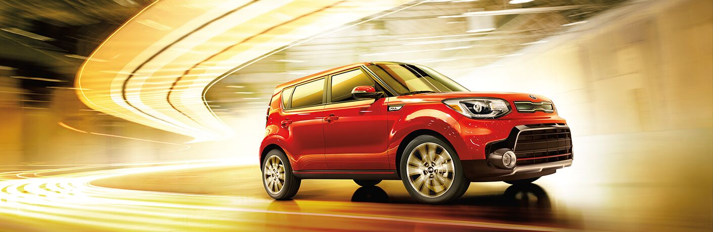 Red 2018 Kia Soul in a lit tunnel