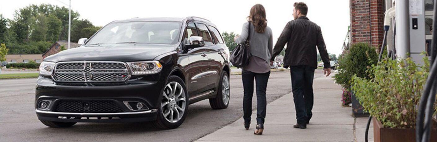 Man and woman walking towards 2019 Dodge Durango