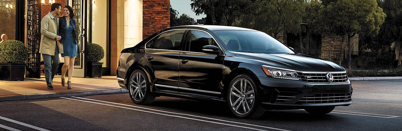 2016 Volkswagen Passat parked with a man and a women walking toward it