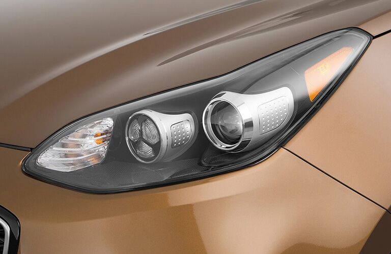 gold 2018 kia sportage headlight close up