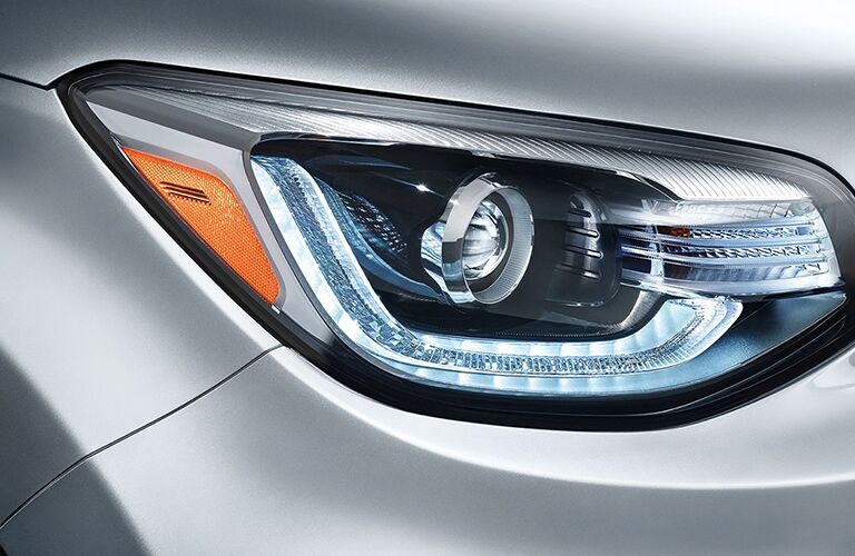 silver 2018 kia soul head light close up