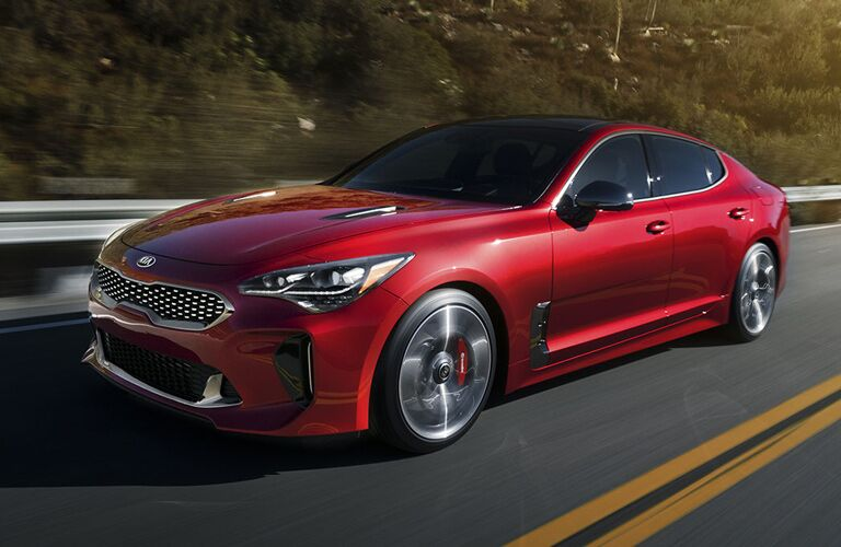 red 2018 kia stinger on road