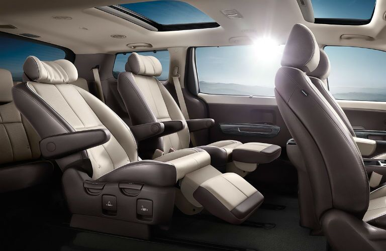 seating inside a 2018 kia sedona with sun in background