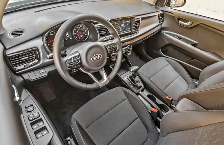 2020 Kia rio interior shot from overhead of driver seat, showing both seats, wheel and dashboard