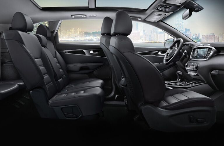 2020 Kia Sorento interior shot through passenger doors showing front and second row with view through windows