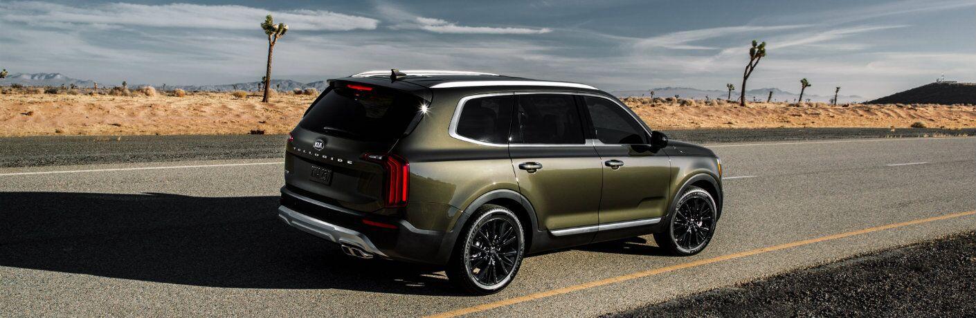 2020 Kia Telluride driving down a desert road