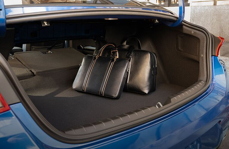 2021 Kia K5 interior of trunk showing bags inside