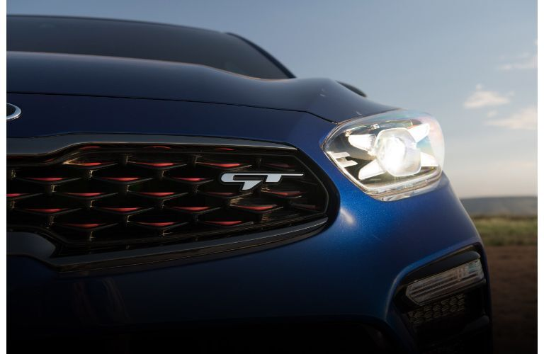 2021 Kia Forte GT logo on front grille blue paint