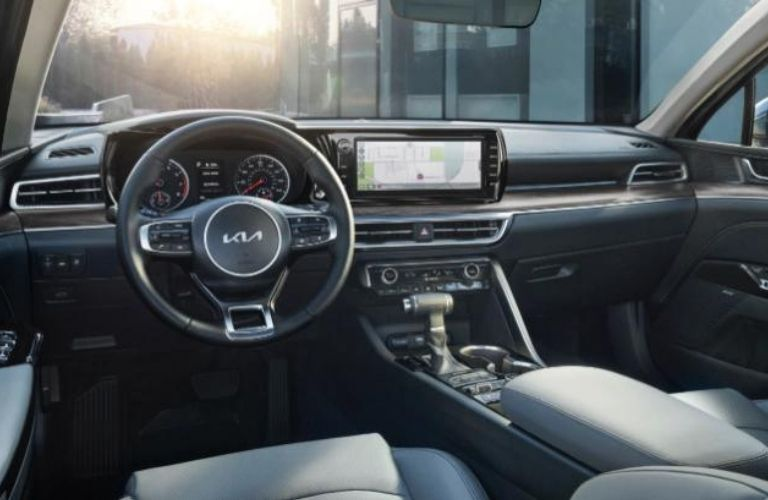 A close-up of the steering wheel and dashboard in the 2022 Kia K5