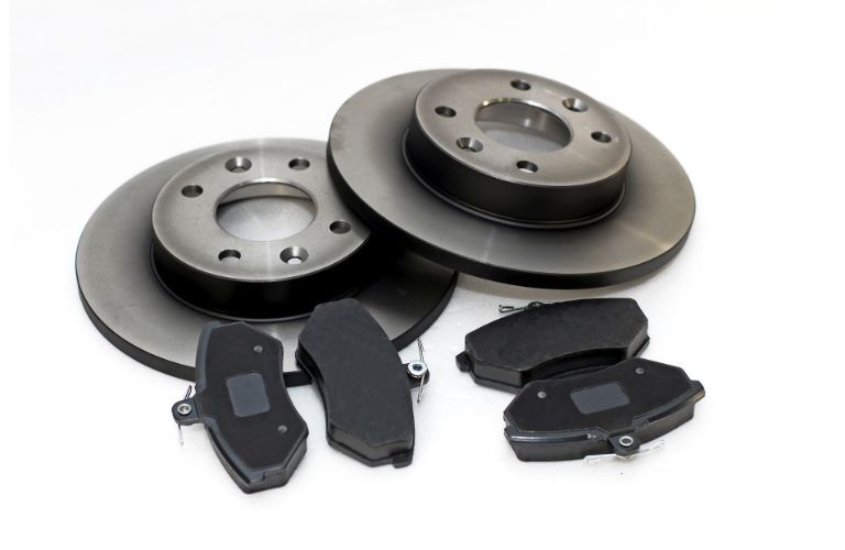 Stock photo of brake pads and rotors four pads two rotors