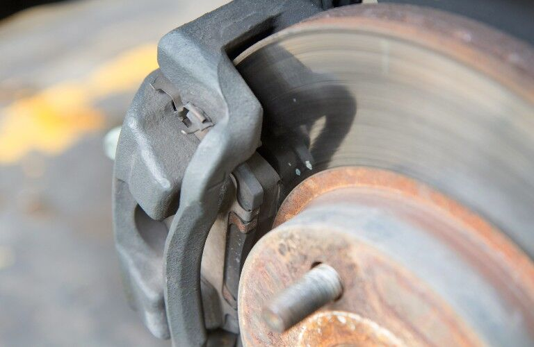 stock photo of close up on brake rotor and worn pad