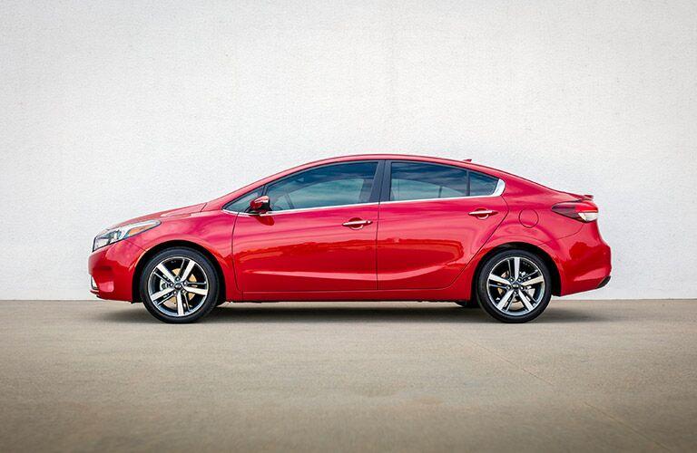 red 2017 Kia Forte side profile