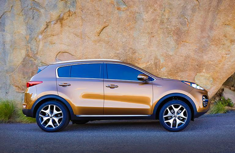 rust colored 2017 Kia Sportage side profile