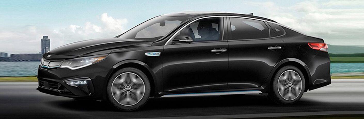 Side profile of black 2020 Kia Optima