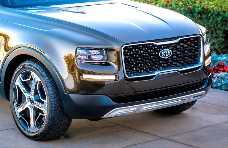 2020 Kia Telluride exterior shot close up of front hood, headlights, and unique tiger nose variation grille with Kia badge