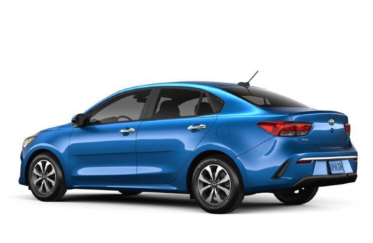 Side and rear view of a blue-colored 2021 Kia Rio sedan